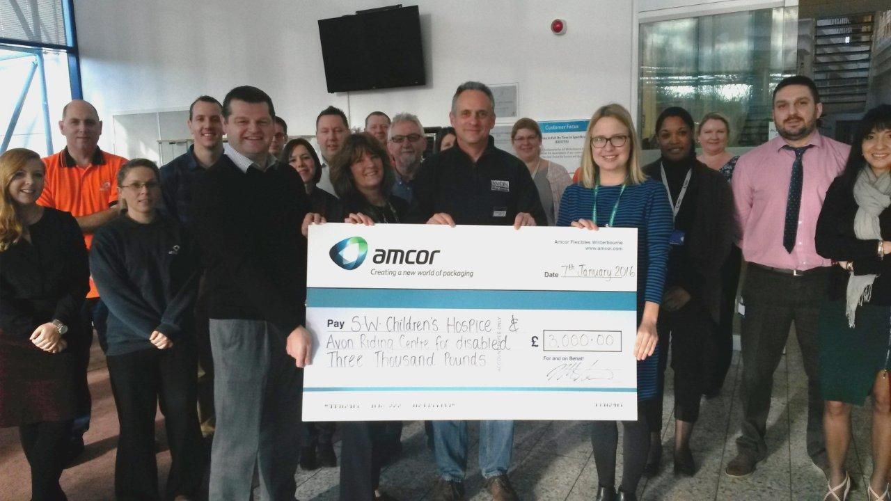 Some employees from Amcor Flexibles, Winterbourne at the presentation. Holding the 'cheque' front row: Steve Morton (GM Amcor Winterbourne), Anita Weidekamp (Business Admin Manager, Amcor Winterbourne), Andrew Manning (CEO, Avon Riding Centre), Katie Edmondson (Fund Raiser (?), SW Children's Hospice) During the presentation Andrew and Katie warmly thanked all Amcor Winterbourne employees for their kind generosity and support.